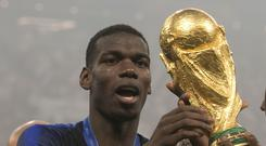 Paul Pogba celebrates with the World Cup trophy after France's 4-2 final win over Croatia (Owen Humphreys/PA)