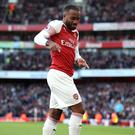 Arsenal's Alexandre Lacazette celebrates scoring his side's first goal of the game during the Premier League match at the Emirates Stadium, London.