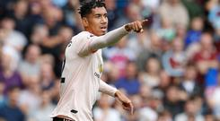 Manchester United's Chris Smalling will sign a new deal at Old Trafford (Martin Rickett/PA)