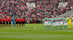 United for a Cork hero: The teams line up for a minute's silence to pay tribute to Liam MIller. Photo: PA