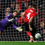 Derby's English goalkeeper Scott Carson (L) dives to save a penalty from Manchester United's English defender Phil Jones. Photo: AFP/Getty