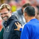 Liverpool manager Jurgen Klopp (left) will go head to head with Chelsea's Maurizio Sarri again this weekend (Martin Rickett/PA).