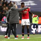 Jose Mourinho (left) and Paul Pogba had a heated touchline conversation in the 2-0 defeat to Tottenham in January 2018 (John Walton/PA)