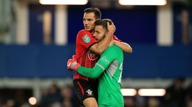Southampton's Cedric Soares and goalkeeper Angus Gunn celebrate after beating Everton on penalties (Peter Byrne/PA)