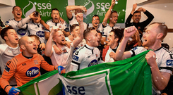 Dundalk players celebrate after securing the league title on Friday night. Photo: Sportsfile