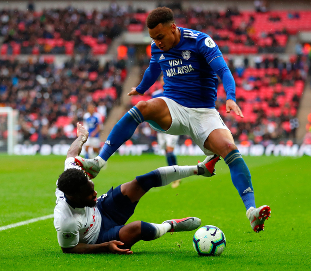 Cardiff City's Josh Murphy is tackled by Danny Rose during yesterday's Premier League clash at Wembley. Photo: Catherine Ivill/Getty
