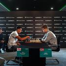 Trent Alexander-Arnold and Magnus Carlsen during their match in Manchester (Anthony Devlin/PA)