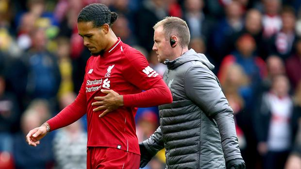 Liverpool defender Virgil van Dijk has been playing with a rib injury for the last month (Dave Thompson/PA).