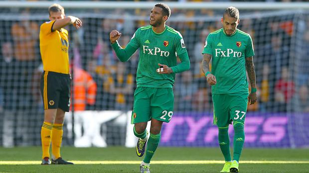 Watford's Etienne Capoue (centre) celebrates opening the scoring at Molineux. (Nick Potts/PA)
