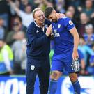 Cardiff manager Neil Warnock (left) celebrates his side's first win of the season with Callum Paterson (Simon Galloway/PA)