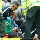 Glenn Murray receives treatment on the pitch at St James' Park (Owen Humphreys/PA)