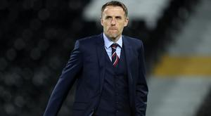 Phil Neville, pictured, believes Marco Ianni should be sacked (Andrew Matthews/PA)