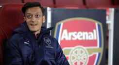Mesut Ozil missed Arsenal's win over Tottenham with a back injury (Nick Potts/PA)