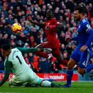 Liverpool's Sadio Mane scores his side's fourth goal during yesterday's Premier League victory over Cardiff City at Anfield. Photo: Dave Thompson