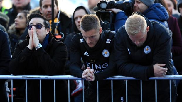 Jamie Vardy, centre, paying his respects outside the King Power Stadium on Monday (Mike Egerton/PA)