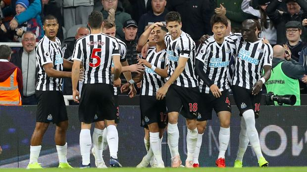 Ayoze Perez, centre, celebrates his goal with his Newcastle team-mates (Owen Humphreys/PA)