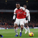 Alexandre Lacazette lures Alisson towards him just moments before firing home Arsenal's equaliser against Liverpool at the Emirates Stadium yesterday. Photo: David Klein/Reuters