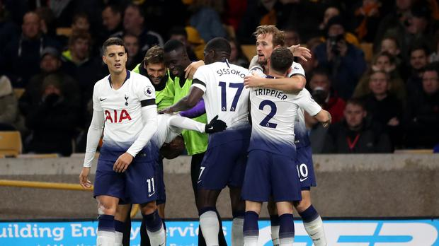 Tottenham's Harry Kane, back right, celebrates his goal in Spurs' 3-2 win at Wolves. (Nick Potts/PA)