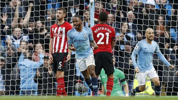 Raheem Sterling celebrates scoring City's fourth goal at the Etihad (Martin Rickett/PA)