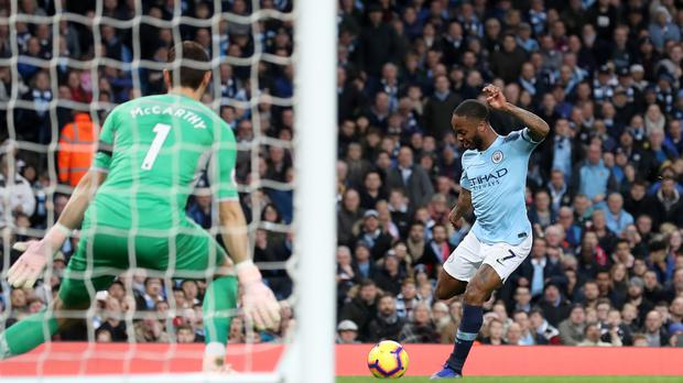 Raheem Sterling scores Manchester City's fifth goal of the afternoon (Martin Rickett/PA)