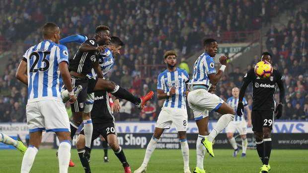 Huddersfield Town's Christopher Schindler scores his side's first goal of the game during the Premier League match at The John Smith's Stadium, Huddersfield.