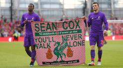 Donations have been flooding in for a fundraising page for injured Liverpool fan Sean Cox (Niall Carson/PA).