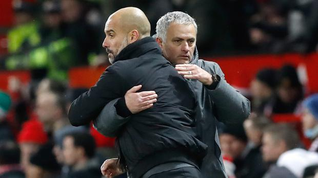 Pep Guardiola, left, and Jose Mourinho, right, meet in the Manchester derby on Sunday (Martin Rickett/PA)