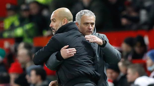 Pep Guardiola (left) faces his old rival Jose Mourinho this weekend (Martin Rickett/PA)