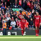 Mohamed Salah, centre, put Liverpool ahead in a chaotic minute (Barrington Coombs/PA)