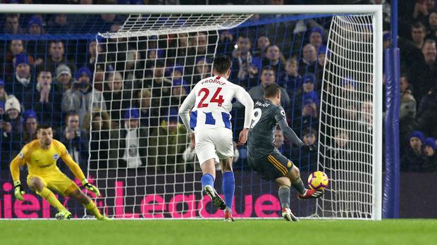 Leicester City's Jamie Vardy scores his side's first goal of the game from the penalty spot during the Premier League match at The Amex Stadium, Brighton.