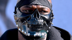 Deontay Wilder wears a mask at yesterday's weigh-in at Los Angeles Convention Center ahead of tonight's fight with Tyson Fury. Photo: Harry How/Getty Images