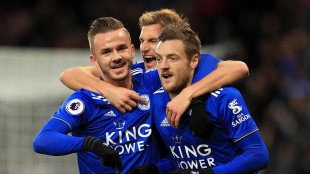 Leicester City's Jamie Vardy (right) celebrates his goal with James Maddison (left) and Marc Albrighton. (Mike Egerton/PA)