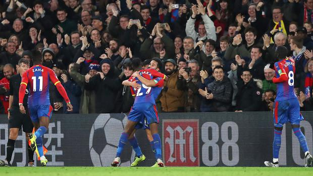 Crystal Palace's Andros Townsend (centre) celebrates scoring his side's second goal of the game with team-mates during the Premier League match at Selhurst Park, London.
