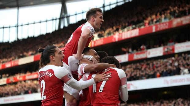 Arsenal's Pierre-Emerick Aubameyang is mobbed (Nick Potts/PA)