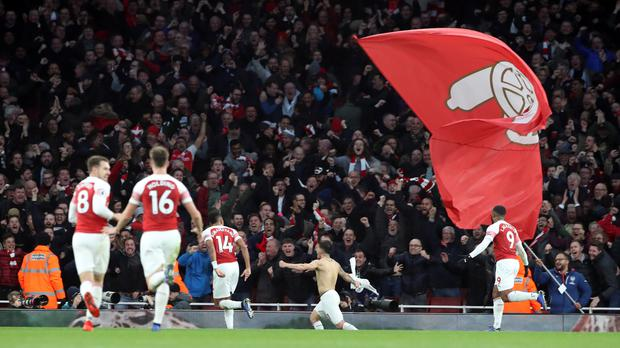 Arsenal's Lucas Torreira celebrates scoring his side's fourth goal of the game during the Premier League match at Emirates Stadium, London.
