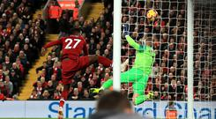 Liverpool's Divock Origi (left) attempts a shot on goal during the Premier League match at Anfield, Liverpool.