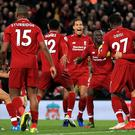 A late Merseyside derby winner meant Liverpool maintained the pressure on Premier League leaders Manchester City (Peter Byrne/PA).