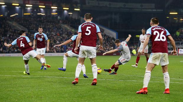 James Milner opened the scoring for Liver[pool as thye won 3-1 at Burnley (Nigel French/PA)