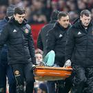 Rob Holding was carried off on a stretcher after suffering the injury on Wednesday (Martin Rickett/PA)