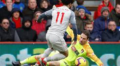 Mo Salah goes around Bournemouth's goakeeper Asmir Begovic before completing his hat-trick yesterday. Photo: Peter Nicholls/Reuters