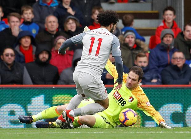 Mo Salah goes around Bournemouth s goakeeper Asmir Begovic before  completing his hat-trick yesterday. a1f57de26