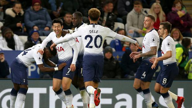 Tottenham's Son Heung-min (second left) celebrates his opener (Nigel French/PA)