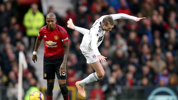 Manchester United's Ashley Young (left) and Fulham's Andre Schurrle battle for the ball during the Premier League match at Old Trafford, Manchester.