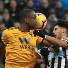 Newcastle's Ayoze Perez (right) and Wolves' Willy Boly battle for the ball (Owen Humphreys/PA)