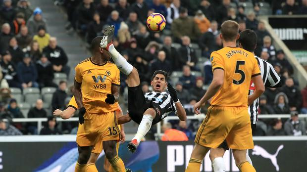 Newcastle 's Ayoze Perez attempts an overhead kick during the 2-1 home defeat by Wolves (Owen Humphreys/PA)