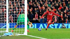 Liverpool's Mohamed Salah scores past Napoli's David Ospina at Anfield last night. Photo: PA