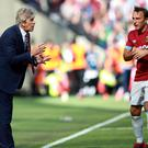 Mark Noble, right, remains an important player for Manuel Pellegrini (Ian Walton/PA)