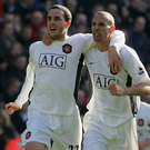 John O'Shea celebrates with Rio Ferdinand after scoring the winner against Liverpool in March 2007. Photo: Man Utd via Getty
