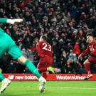 Liverpool's Xherdan Shaqiri (centre) celebrates scoring his side's third goal of the game during the Premier League match at Anfield, Liverpool.