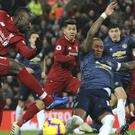 Ashley Young (right) looked understandably pained after the Liverpool defeat (Rui Vieira/AP)